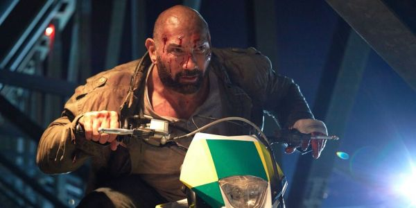 Watch Dave Bautista Dodge Bullets on a Motorcycle on a Stadium
