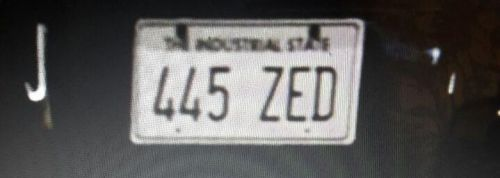 """Why are license plates reading """"Industrial State"""" and """"Highway State"""" used in Jarmusch's """"Ghost Dog""""?"""