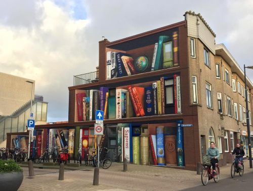 Street Art for Book Lovers: Dutch Artists Paint Massive Bookcase Mural on the Side of a Building