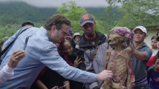 DARK TOURIST Review: A Wide, Shallow World Of Weirdness