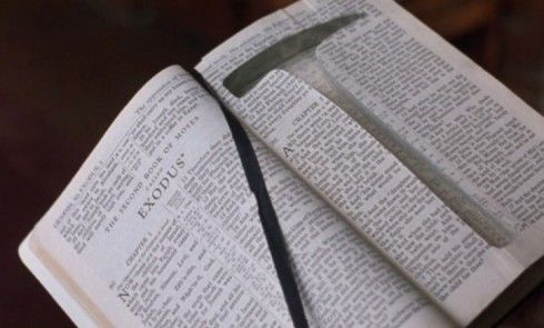 How did Andy cut the bible pages so perfectly to hide the rock hammer?